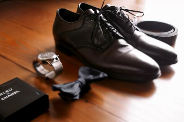 men-accessories-laid-out-on-wooden-floor